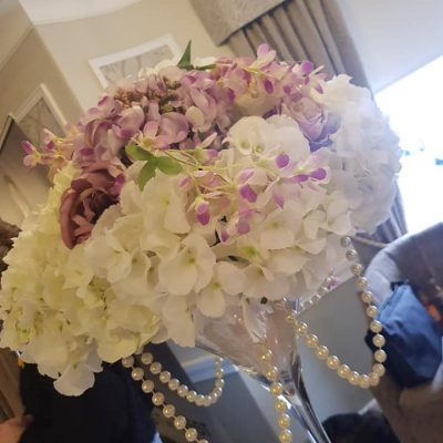 Large hydrangea and lilac flowers with hanging pearls